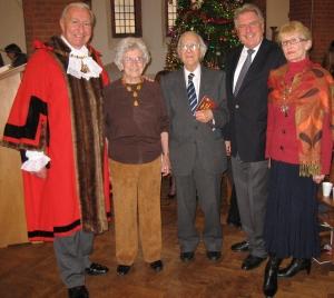 "Bexley Mayor Cllr Alan Downing, Bexley resident Florence Russell, who read ""Christmas Bells"", Reg Bartlett, who read Sir John Betjeman's Advent 1955, David Evennett MP and Mayoress Cllr Ros Downing."
