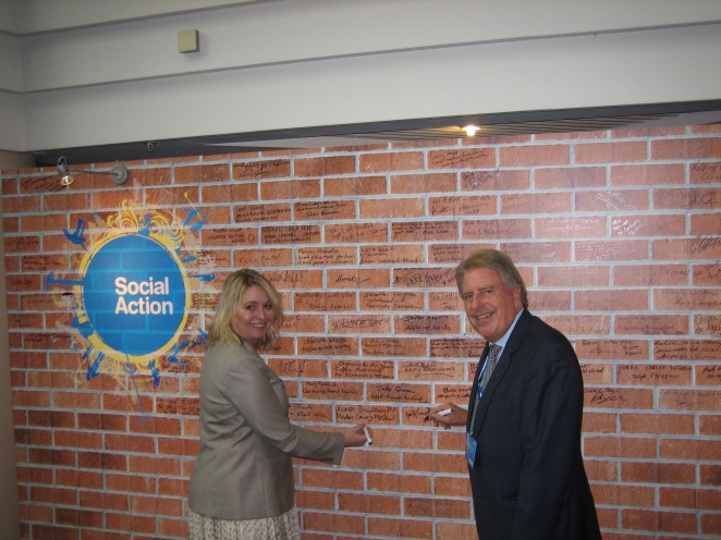 David and Home Office Minister Karen Bradley MP signing Social Action Wall at Party Conference Mon 29 Sept 2014