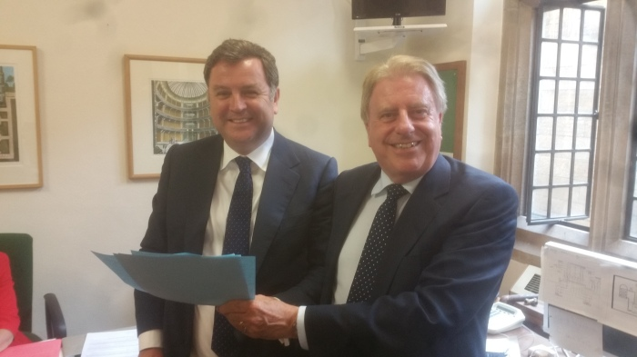 Two Lord Commissioners sign their last Treasury documents on behalf of the Cameron Government