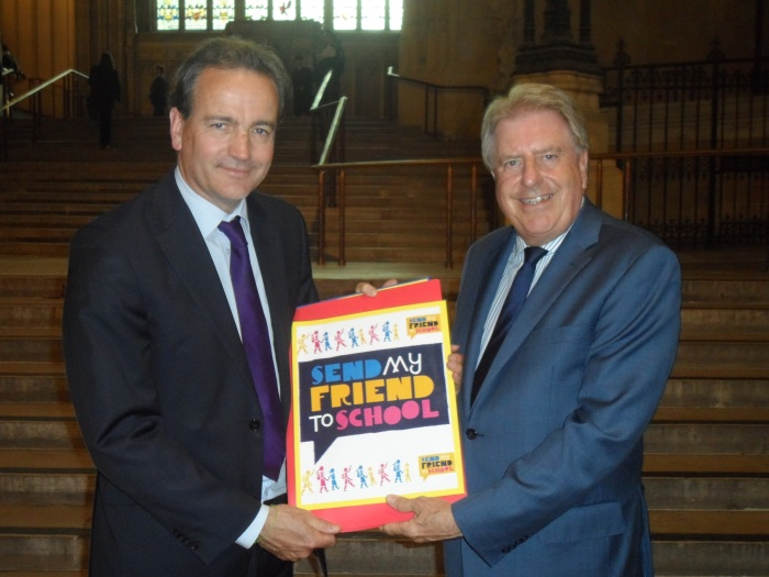 Presenting Nick Hurd MP, Parliamentary Under Secretary State at the Department for International Development, with the book from Bursted Wood Primary School for the Send My Friend To School campaign